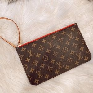 Louis Vuitton clutch *never used*